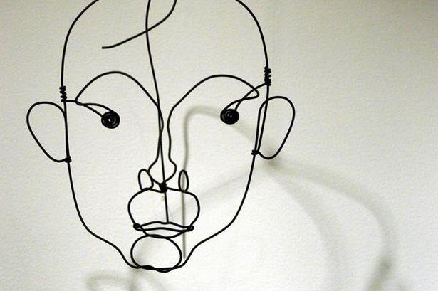 דיוקן של חואן מירו שפיסל בחוט אלכסנדר קלדר